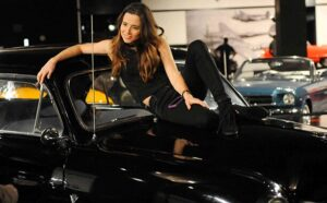 Caption: Linda Cardellini with her car