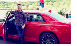 Chris Harrison with his car