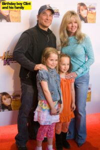 Caption: Model Lily Pearl Black with her family