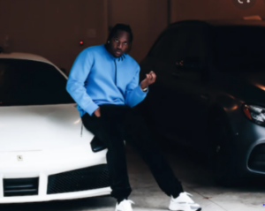 Pusha T with his car