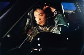 Billie Eilish sitting inside her car