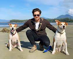 Caption: Entertainer Chris McNally with his dogs