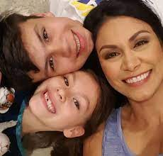 Caption: Anchor Wendy Corona with her children