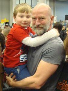 Caption: Graham McTavish with his son