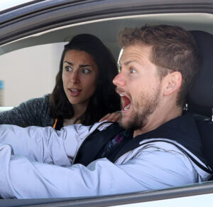 Caption: Drew Lynch with his car