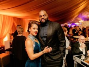 Caption: Player Michael Oher with his wife