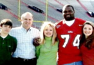 Caption: Player Michael Oher with his family