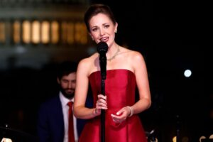 Caption: Laura Osnes at a party