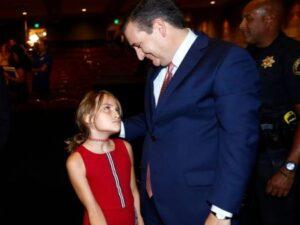 Caption: Caroline Camille Cruz with her father