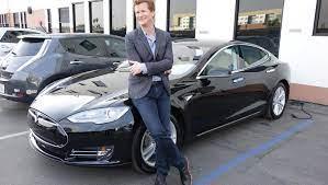 Caption: Jonathan Mangum with his car