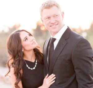 Caption: Scott Frost with his wife
