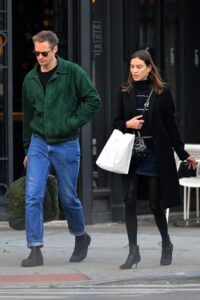 Caption: Alexander Skarsgard with his British girlfriend Alexa Chung