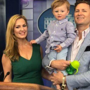 Caption: Emerald Robinson with her husband Garrick Davis and her son