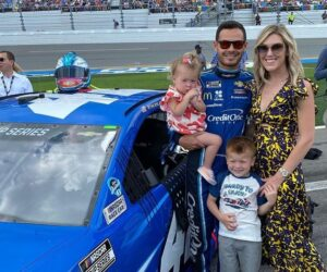 Caption: Katelyn Sweet and her family with their car