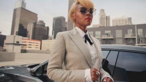 Caption: Janelle Monae with her car