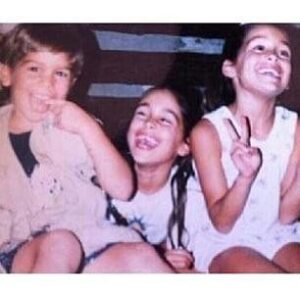 Caption: J J Garcia with his sisters