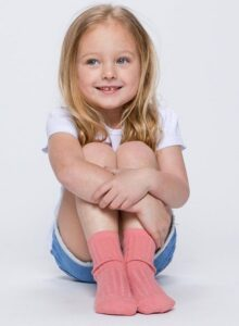 Caption: ava busby posing for a photo